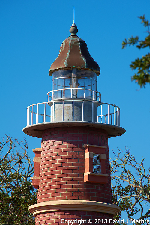 Lighthouse Replica at the Hidden Treasure Rum Bar and Grill. It is right across the street from the real Ponce de Leone Inlet Lighthouse near Daytona, Florida. Image taken with a Nikon D700 and 28-300 mm VR lens (ISO 200, 300 mm, f/13, 1/400 sec).