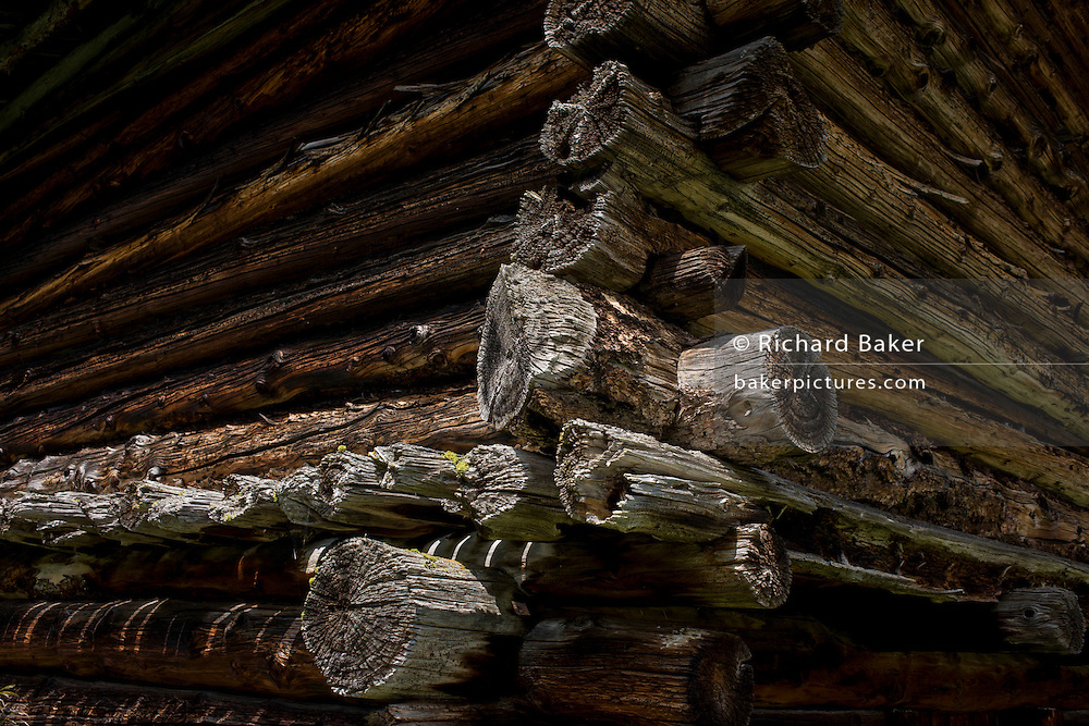 Corner of typical old Alpine timber hut in the Pralongià above San Cassiano-St. Kassian in the Dolomites, south Tyrol, northern Italy. In winter, the Pralongià meadows are the heart of Alta Badia's skiing area.
