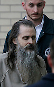 Brian David Mitchell is escorted by a U.S. Marshall as he arrives at the federal court house Friday, Dec. 10 2010 in Salt Lake City. Mitchell was found guilty for the June 5 2002 kidnapping of Elizabeth Smart. (AP Photo/Colin E Braley)