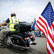 A large American flag on the back of a bike participating in the annual Rolling Thunder motorcycle rally through downtown Washington DC on May 29, 2011. This shot was taken as the riders were leaving the staging area in the Pentagon's north parking lot, where thousands of bikes and riders had gathered.
