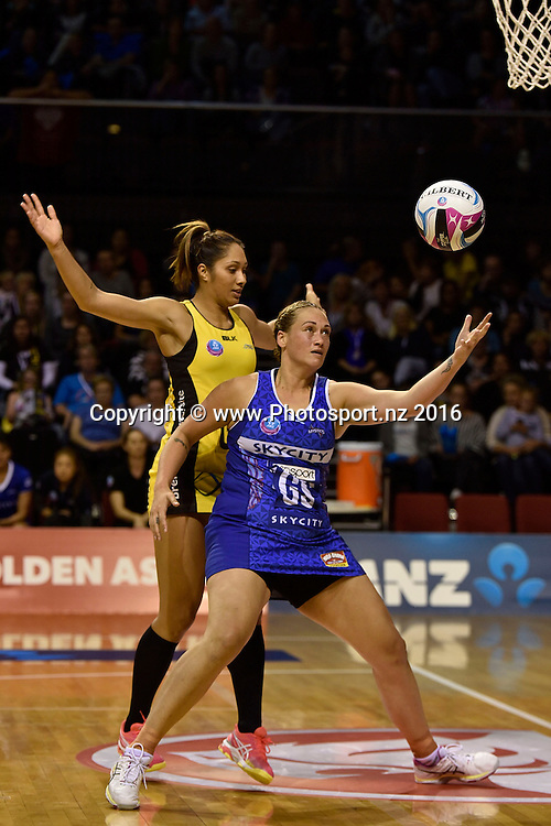 Mystics' Cathrine Tuivaiti (R takes a pass with Pulse's Phoenix Karaka during the ANZ Champs - Pulse v Mystics netball match at TSB Arena in Wellington on Monday the 18 April 2016. Copyright Photo by Marty Melville / www.Photosport.nz