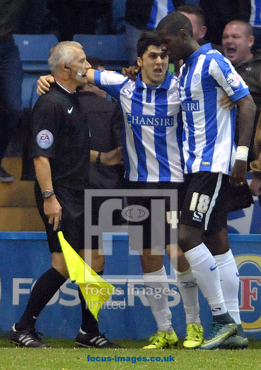 Fernando Forestieri (centre) of Sheffield Wednesday celebrates his goal against Nottingham Forest with the assistant referee during the Sky Bet Championship match at Hillsborough, Sheffield<br /> Picture by Graham Crowther/Focus Images Ltd +44 7763 140036<br /> 31/10/2015