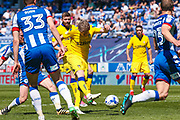 Leeds United midfielder Eunan O'Kane (14) with a shot  during the EFL Sky Bet Championship match between Wigan Athletic and Leeds United at the DW Stadium, Wigan, England on 7 May 2017. Photo by Simon Davies.