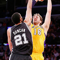 19 March 2014: Los Angeles Lakers center Pau Gasol (16) takes a jump shot over San Antonio Spurs forward Tim Duncan (21) during the San Antonio Spurs 125-109 victory over the Los Angeles Lakers at the Staples Center, Los Angeles, California, USA.