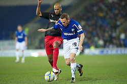 CARDIFF, WALES - Tuesday, February 1, 2011: Cardiff City's Craig Bellamy and Reading's Jimmy Kebe during the Football League Championship match at the Cardiff City Stadium. (Photo by Gareth Davies/Propaganda)