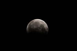 August 7, 2017 - Bhubaneswar, Orissa, India - Moon looks in the sky at partial Lunar Eclipse time in the eastern Indian state Odisha's capital city Bhubaneswar on 7 August 2017. (Credit Image: © Str/NurPhoto via ZUMA Press)