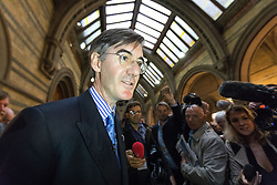 © Licensed to London News Pictures . 02/10/2017. Manchester, UK. JACOB REES-MOGG leaves a fringe , right-wing Bruges Group event at Manchester Town Hall , surrounded by media , during the second day of the Conservative Party Conference at the Manchester Central Convention Centre . Photo credit: Joel Goodman/LNP