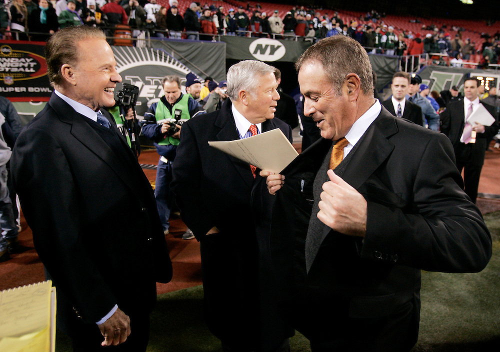 Former ABC Monday Night Football announcer Frank Gifford and current announcer Al Michales on the field before the last Monday Night Football game on ABC between the New York Jets and the New England Patriots at Giants Stadium in East Rutherford NJ Monday 26 December 2005