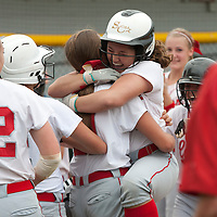 "6-9-2014: Neshannock's Jenne DeLuca leaps into the arms of Cassidy Burrelli after hitting a game-tying three-run homerun in the bottom of the seventh inning off of Clayburg Kimmel's Kiersten Coho in the PIAA Class ""A"" state semifinals. The Lady Lancers eventually fell to the Bulldogs by a score of 5-4 in extra innings at Hempfield Area High School in Greensburg, PA."