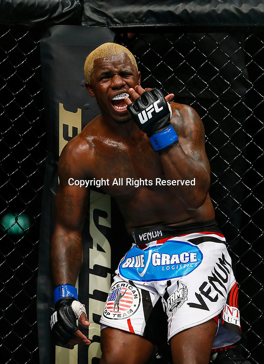 08.03.2014 London, England. Melvin Guillard (white and red logo shorts) looks angered after an apparant eye poke from Michael Johnson (white shorts) in a 3 round Lightweight bout on the Main Card at UFC Fight Night London from the O2 Arena.