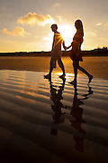 Ad campaign: Couple walking on Praia Grande beach on Ilha do Mel, Brazil