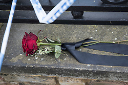 © Licensed to London News Pictures. 21/02/2018. London, UK. A single red rose tied with a black ribbon has been placed next to a police cordon on Bartholomew Road, Camden, where one of two stabbings took place yesterday evening, killing two young men. Police were called to a second disturbance in the area, in which a second man was stabbed to death, and are currently investigating if the two incidents are connected. Photo credit: Peter Macdiarmid/LNP