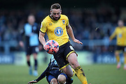 Sammy Moore is fouled during the The FA Cup match between Wycombe Wanderers and AFC Wimbledon at Adams Park, High Wycombe, England on 7 December 2014.