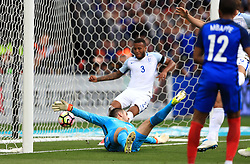 France's Samuel Umtiti scores his side's first goal of the game past England goalkeeper Tom Heaton