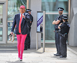 Roland Saunders as Donald Trump highlights his show outside the Scottish Parliament.<br /> <br /> &copy; Dave Johnston/ EEm