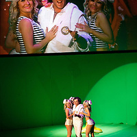 Picture shows : Thomas Walker as Lindoro with the bunny girls..Picture  ©  Drew Farrell Tel : 07721 -735041..A new Scottish Opera production of  Rossini's 'The Italian Girl in Algiers' opens at The Theatre Royal Glasgow on Wednesday 21st October 2009..(Soap) opera as you've never seen it before..Tonight on Algiers.....Colin McColl's cheeky take on Rossini's comic opera is a riot of bunny girls, beach balls, and small screen heroes with big screen egos. Set in a TV studio during the filming of popular Latino soap, Algiers, the show pits Rossini's typically playful and lyrical music against the shoreline shenanigans of cast and crew. You'd think the scandal would be confined to the outrageous storylines, but there's as much action off set as there is on.... .Italian bass Tiziano Bracci makes his UK debut in the role of Mustafa. Scottish mezzo-soprano Karen Cargill, who the Guardian called a 'bright star' for her performance as Rosina in Scottish Opera's 2007 production of The Barber of Seville, sings Isabella. .Cast .Mustafa...Tiziano Bracci.Isabella..Karen Cargill.Lindoro...Thomas Walker.Elvira...Mary O'Sullivan.Zulma...Julia Riley.Haly...Paul Carey Jones.Taddeo...Adrian Powter. .Conductors.Wyn Davies.Derek Clarke (Nov 14). .Director by Colin McColl.Set and Lighting Designer by Tony Rabbit.Costume Designer by Nic Smillie..New co-production with New Zealand Opera.Production supported by.The Scottish Opera Syndicate.Sung in Italian with English supertitles..Performances.Theatre Royal, Glasgow - October 21, 25,29,31..Eden Court, Inverness - November 7. .His Majesty's Theatre, Aberdeen  - November 14..Festival Theatre,Edinburgh - November 21, 25, 27 ...Note to Editors:  This image is free to be used editorially in the promotion of Scottish Opera. Without prejudice ALL other licences without prior consent will be deemed a breach of copyright under the 1988. Copyright Design and Patents Act  and will be subject to payment or legal action, where appropriate..Further further