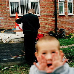 Children playing in their backyard on the Ford Estate in Sunderland. One of the toughest times of year for familes is the school summer holidays. There is nothing for the children to do on the estate, but parents can't afford to take them anywhere, bus fares are just too high.  Currently 3.4 million children live in poverty in the UK.