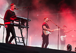 © Licensed to London News Pictures. 28/08/2015. Reading Festival, UK.  Alt J performing at Reading Festival 2015 28 August 2015 Day 1.  In this picture - Gus Unger-Hamilton (left), Joe Newman (centre), Cameron Knight (right). Photo credit: Richard Isaac/LNP