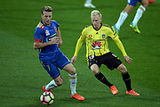 Wellington Phoenix Adam Parkhouse and New Castle Jets' player Andrew Hoole involved in a dribble challenge during the Hyundai A-League, Wellington Phoenix v Newcastle Jets, Westpac Stadium, Wellington, Sunday 26th March 2017. Copyright Photo: Raghavan Venugopal / www.photosport.nz