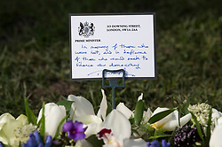 © Licensed to London News Pictures. 22/03/2018. London, UK. A note on a float tribute left by British Prime Minister THERESA AMY at Parliament Square, outside the Houses of Parliament in Westminster, London on the one year anniversary of the Westminster Bridge Terror attack in which lone terrorist killed 5 people and injured several more, in an attack using a car and a knife. The attacker, 52-year-old Briton Khalid Masood, managed to gain entry to the grounds of the Houses of Parliament and killed police officer Keith Palmer. Photo credit: Ben Cawthra/LNP