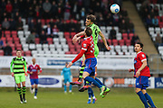 Forest Green Rovers Christian Doidge(9) wins a header against Dagenham's Josh Staunton(32) during the Vanarama National League first leg play off match between Dagenham and Redbridge and Forest Green Rovers at the London Borough of Barking and Dagenham Stadium, London, England on 4 May 2017. Photo by Shane Healey.