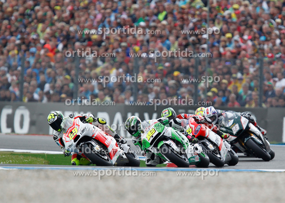 28.06.2014, TT Circuit, Assen, NED, MotoGP, Assen, im Bild 69 Nicky Hayden, 19 Alvaro Bautista, 35 Cal Crutchlow // during the MotoGP Iveco TT Assen at the TT Circuit in Assen, Netherlands on 2014/06/28. EXPA Pictures &copy; 2014, PhotoCredit: EXPA/ Eibner-Pressefoto/ FOTO-SPO_AG<br /> <br /> *****ATTENTION - OUT of GER*****