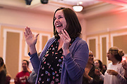 Jenny Hall-Jones laughs and claps her hands during one of the performances of the Faculty Pageant.