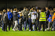 Pitch invasion at the end of the EFL Cup match between Crawley Town and Colchester United at The People's Pension Stadium, Crawley, England on 29 October 2019.