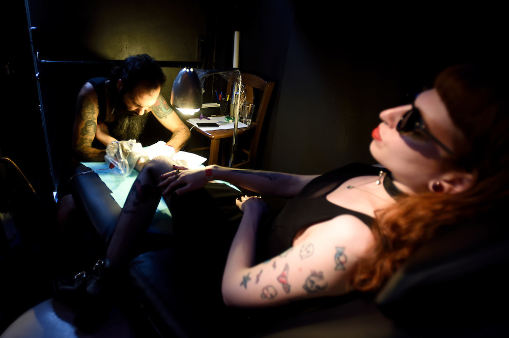 TEL-AVIV, ISRAEL - June 06, 2015: An Israeli woman gets her body tattooed during the 3rd annual tattoo convention in Tel-Aviv on June 6, 2015.The Convention hosted Israeli and international tattoo and piercing artisits. Photo by Gili Yaari