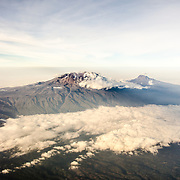 Mount Kilimanjaro Aerial View Summit. An aerial view of Mount Kilimanjaro, the highest peak in Africa, with a snow-covered peak.