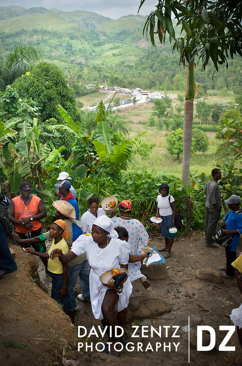Pilgrims worship at the base of trees in the remote village of Ville Bonheur during the Saut D'eau voodoo festival. The 3-day festival attracts voodooists and Catholics from across the country and abroad.