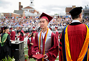Arlington High School student George Chiang leaves the stage diploma in hand during the graduation exercises for the Class of 2017 at the Warren A. Peirce Field in Arlington, June 3, 2017.   [Wicked Local Photo/James Jesson].
