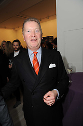 FRANK WARREN at a reception to launch the Saatchi Opus held at the Saatchi Gallery, King's Road, London on 26th November 2009.