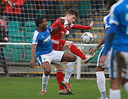 Dover defender Tyrone Sterling & Whitehawk striker Jake Robinson battle for possession during the FA Trophy match between Whitehawk FC and Dover Athletic at the Enclosed Ground, Whitehawk, United Kingdom on 12 December 2015. Photo by Bennett Dean.