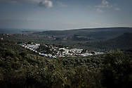 A panoramic view of the Moria camp. Many families lives in a makeshift camp outside Moria camp living in tents in a olives trees plantation. About 8500 migrants and refugees are living in hard condition on the island of Lesvos, many of them outside the organized camp. Moria, Greece. December 12th 2017.