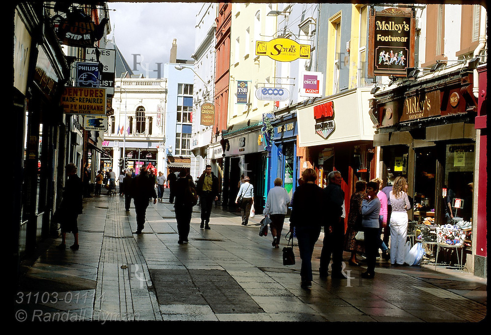 Shoppers fill walking mall on a sunny September day in downtown Cork, Ireland.