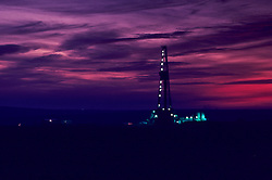 Stock photo of lights from an oil and gas drilling rig at dusk in Texas