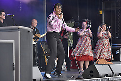 July 23, 2017 - London, United Kingdom - MICHAEL GLAYSHER on stage performing as a young Elvis during the capital's first ever ''Elvis Fest'' to mark the 40th anniversary of the King of Rock'n'Roll's death in 1977. Taking place in Parsloes Park, Dagenham, the festival includes a variety of tribute acts representing Elvis through his career. (Credit Image: © Stephen Chung/London News Pictures via ZUMA Wire)