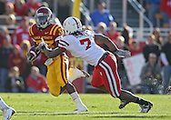 November 06 2010: Iowa State Cyclones running back Alexander Robinson (33) tries to avoid Nebraska Cornhuskers defensive back DeJon Gomes (7) during the first half of the NCAA football game between the Nebraska Cornhuskers and the Iowa State Cyclones at Jack Trice Stadium in Ames, Iowa on Saturday November 6, 2010. Nebraska defeated Iowa State 31-30.