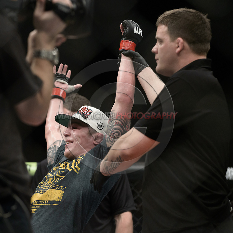"LONDON, ENGLAND, FEBRUARY 16, 2013: Andy Ogle is declared winner of his fight at ""UFC on Fuel TV 7: Barao vs. McDonald"" inside Wembley Arena in Wembley, London on Saturday, February 16, 2013 (© Martin McNeil)"