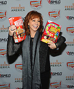 Music icon Reba unveils herself as the face of the 2015 Outnumber Hunger campaign, a partnership between General Mills, Big Machine Label Group and Feeding America, Monday, April 13, 2015, in New York.  People can enter codes from specially marked General Mills products at OutnumberHunger.com to earn meals for local food banks.  (Photo by Diane Bondareff/Invision for General Mills/AP Images)