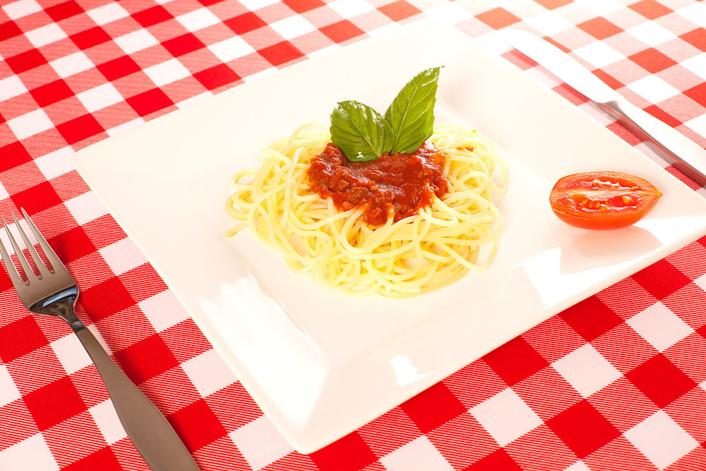 Tiny portion of spaghetti on a plate