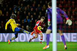 Southampton Forward Adam Lallana (ENG) crosses past Arsenal Defender Bacary Sagna (FRA) - Photo mandatory by-line: Rogan Thomson/JMP - Tel: Mobile: 07966 386802 - 28/01/2014 - SPORT - FOOTBALL - St Mary's Stadium - Southampton v Arsenal - Barclays Premier League.