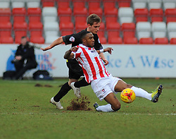 Cheltenham Town's Craig Braham-Barrett challenges for the ball against Bury's Danny Rose - Photo mandatory by-line: Nizaam Jones - Mobile: 07966 386802 - 14/02/2015 - SPORT - Football - Cheltenham - Whaddon Road - Cheltenham Town v Bury - Sky Bet League Two