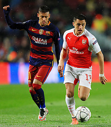 Arsenal's Alexis Sanchez is chased by Neymar of Barcelona  - Mandatory byline: Matt McNulty/JMP - 16/03/2016 - FOOTBALL - Nou Camp - Barcelona,  - FC Barcelona v Arsenal - Champions League - Round of 16