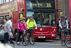 © Licensed to London News Pictures. 08/07/2015. London, UK. Many cyclists are seen on the road during rush hour near Liverpool Street station in London this evening. London transport workers begin strike action tonight, which will continue tomorrow. Photo credit : Vickie Flores/LNP