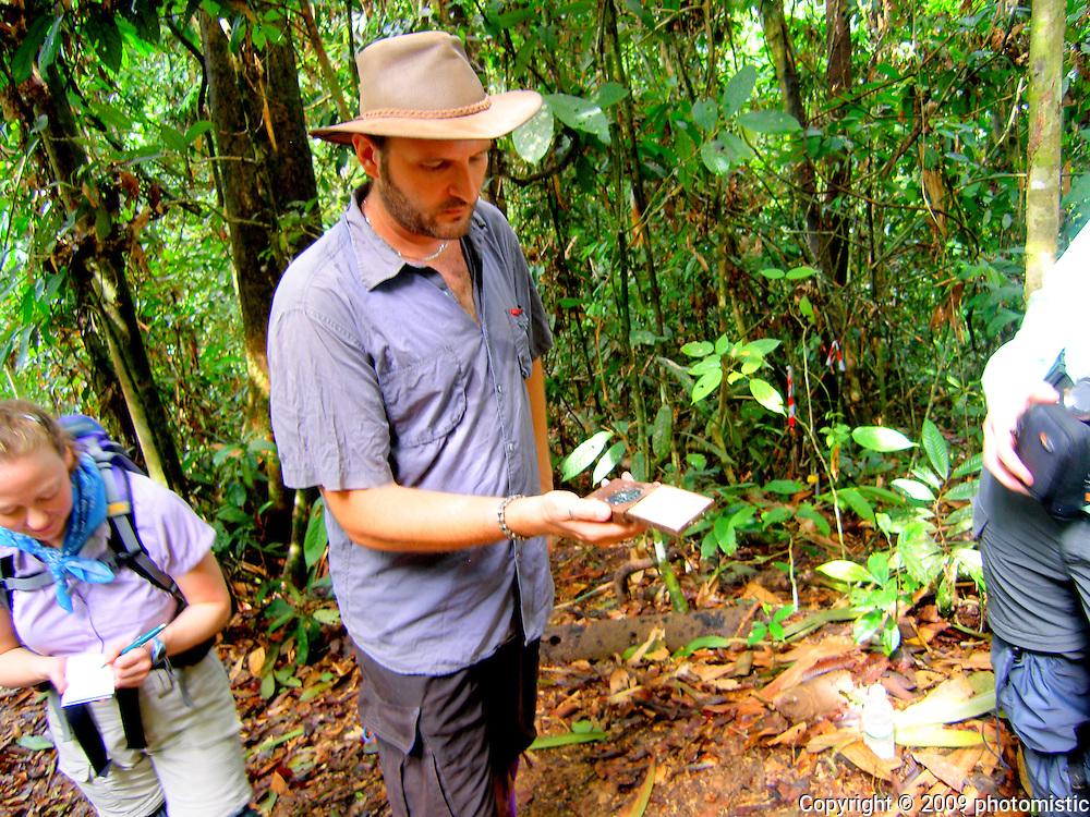 Glenn Reynolds<br /> explaining how to use<br /> the densiometer<br /> malua<br /> borneo, malaysia