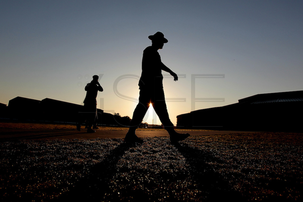 As the sun begins to rise a drill instructor makes his way across one of the bases many training areas.  Marine Corps Recruit Depot at Parris Island in South Carolina is where all male recruits living east of the Mississippi River and all female recruits from all over the US receive their arduous twelve week training in their quest to become marines. Even though there are two current active wars and a weak economy, recruitment has not been effected.  Actually, recruiting numbers have increased, with more young men and women looking toward the military for answers.