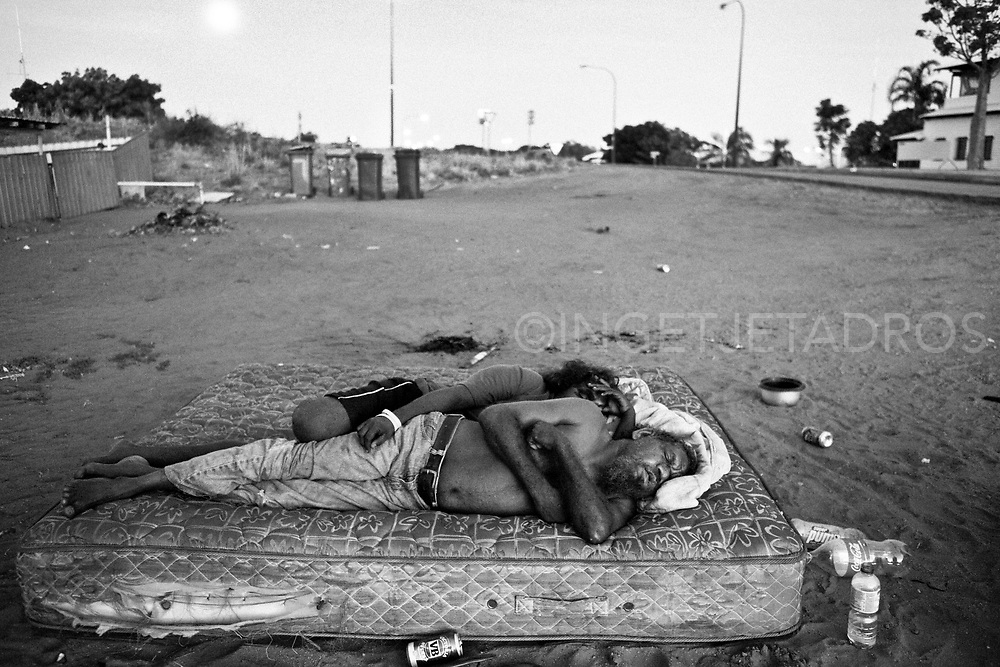 Jackie and Geraldine sleeping on a mattress in front of<br />
