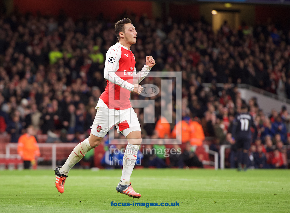 Mesut Ozil of Arsenal celebrates after heading the ball past goalkeeper Eduardo of Dinamo Zagreb to score the opening goal during the UEFA Champions League match at the Emirates Stadium, London<br /> Picture by Alan Stanford/Focus Images Ltd +44 7915 056117<br /> 24/11/2015